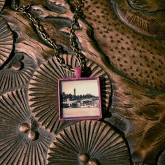 Pink framed pendant with chain - $30CAD from 'Home is in the Eye of the Beholder' 2010 - Cityscapes and Living Spaces