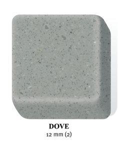 corian dove grey. Goes with boading creme stacked stone backsplash