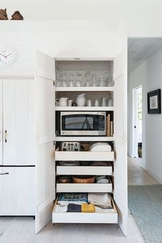 Love that organization system. Let's hide all the appliances!  - VL                                                                                                                                                                                 More Microwave Storage, Kitchen Microwave Cabinet, Microwave In Pantry, Ikea Kitchen Storage Cabinets, Ikea Pantry Storage, Ikea Kitchen Drawer Organization, Kitchen Ideas For Storage, Tall Kitchen Cabinets, Corner Pantry Organization