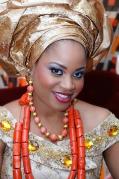 Ify is adorable in coral, pink, amber and gold. #BellaNaijaBride, african, #makeup, Igbo bride