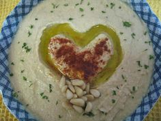 If you're looking for the best homemade hummus recipe without Tahini, this is it! Learn how to make a really quick and delicious hummus without tahini. It's low fat, and packed full of protein!
