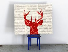 Deer Wall Art on Text, Antler Wall Art, Animal Silhouette, Deer Head Silhouette, Deer Head with Antlers in Red in Vintage Book Pages. $24.00, via Etsy.