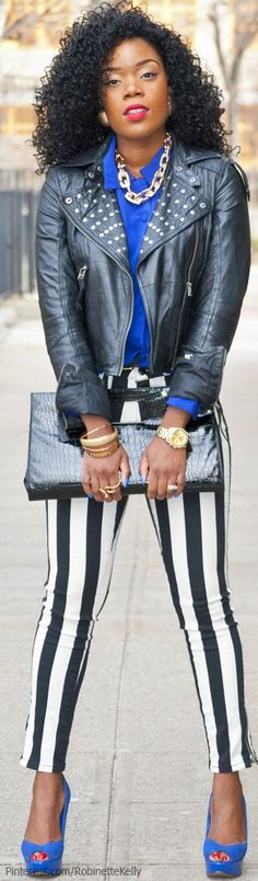 lovin the jeans (leggings?) and the pops of blue! Not a fan of the jacket or the clutch