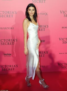 Demure: Following the show, Kendall slipped into an understated ivory dress, which she teamed with bejewelled heels