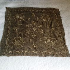 Magnificent ancient fabric square,entirely hand embroidered with golden metal threads and sequins,representing stylized crowns at each corner and a