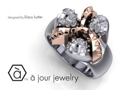 Another Version of our Very popular Drill Bit Ring... this one is done in solid 18kt Rose Gold & White Gold with Black and White Diamonds!!! For questions please contact me here: http://www.ajourjewelry.com/contact.html or call me at (401) 254-2565