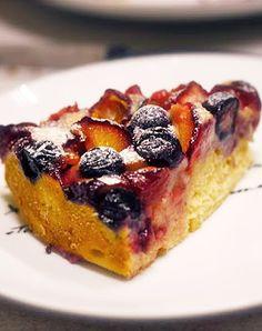 Scrumpdillyicious: Bublanina - Czech Bubble Cake ~ 5/8 c. light brown sugar...3 T. softened butter...2 large eggs...1 c. plain flour...1 t. baking powder...1 c. plain yoghurt...1 t. orange zest...1 t. Grand Marnier...1/2 t. almond vanilla extract...1/8 t. salt...1 c. each plums, cherries, strawberries & blueberries...crème fraîche, for garnish (opt)