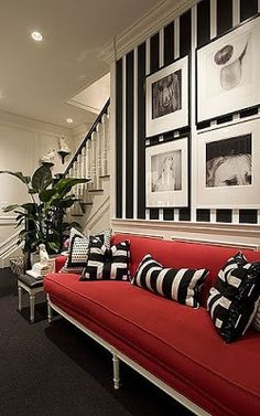 Love the contrast and intensity! Red sofa against black and white stripes. #decor