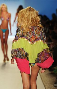 A model walks the runway during the Cia Maritima show at Mercedes-Benz Fashion Week Swim 2012 at The Raleigh on July 17, 2011 in Miami Beach, Florida.