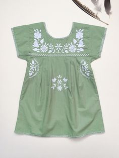 'JANE' DRESS - PEAR-GREEN WITH IVORY EMBROIDERYTaking the comfort and practicality of traditional 1970s Mexican embroidered dresses and combining with a heritage Swedish folk influence. This sw...