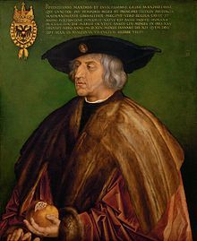 Maximilian I~  Portrait by Albrecht Dürer, 1519 (Kunsthistorisches Museum, Vienna). Maximilian holds his personal emblem, the pomegranate.  King of the Romans (also known as King of the Germans)  Reign 16 February 1486 – 12 January 1519  Coronation 9 April 1486  Predecessor Frederick III  Successor Charles V  Holy Roman Emperor, Archduke of Austria  Reign 19 August 1493 – 12 January 1519
