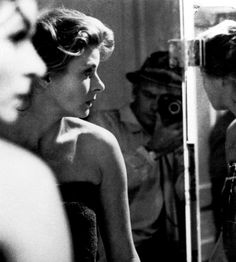 Yul Brynner takes a picture of Ingrid Bergman (ca. 1955)
