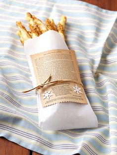 Holiday (or anytime!) Cheese Straws wrapped in a cotton napkin lined with wax paper and tied with raffia. (recipe included)