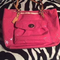 Pink patten leather coach imprint bag Patten leather pink coach purse. Very big. Wearing on handles, around clasp, inside has done wear and discoloration, small ink stain picture above, bottom of bag in good condition. Purchased at coach outlet store. Coach Bags Satchels