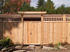 Sandringham Cedar Fence/Gate with pergola gate brace and lattice topper.  Supplied and installed by Lanark Cedar