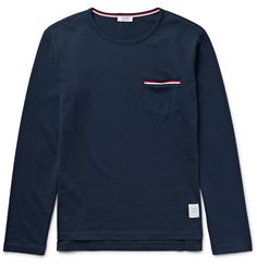 When it comes to mastering the details, no one does it better than <a href='http://www.mrporter.com/mens/Designers/Thom_Browne'>Thom Browne</a>. Take this navy T-shirt, for example - it's made from soft cotton-jersey and kitted out with all of the features you'd expect from the label: a smart cut, buttoned side slits and signature striped trims. Wear yours with cool sweats and box-fresh sneakers.