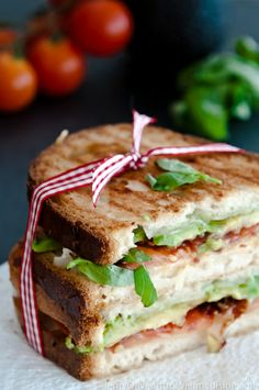 Gluten Free Panini with pecorino, avocado, bacon and basil  Gotta try this to see what the gluten free people are eating