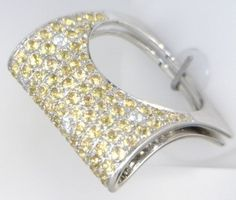 18KT WHITE GOLD YELLOW SAPHHIRE AND DIAMOND RING