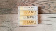 Check out this item in my Etsy shop https://www.etsy.com/listing/249050854/nunya-beeswax-lip-balm-with-vitamin-e