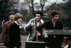 BARRACKS Photo of The Who, Keith Moon, Roger Daltrey, John Entwistle (lighting cigarette), Pete Townshend - posed, group shot