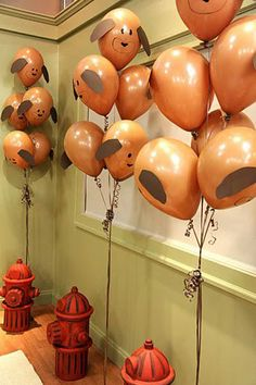 Tape ear-shaped construction paper to balloons and draw on dog faces with permanent marker.