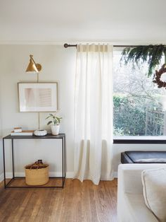 Our window makeover with some fresh holiday greens and help from Minwax! An easy DIY that adds tons of sophistication to this living room space.