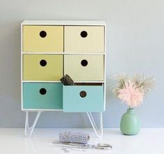 Transform IKEA's moppe mini chest drawers by painting it your favorite colors and adding legs. It looks great on your desk or shelf.