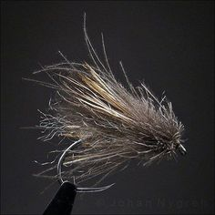 "johan-nygren: ""Mugly Caddis CdC. Head by CdC in split wire trimmed to shape. Floats like a cork. Here tied on Dohiku 302/10. #flytying #flyfishing #bigtrout #trout #rainbow #muglycaddis #peakvise..."