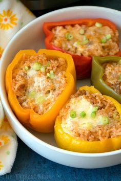 These easy Instant Pot stuffed peppers will be your favorite pressure cooker meal! Stuffed with cheesy ground beef and rice they're packed with flavor!