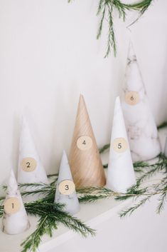 This Holiday Advent Calendar Is Actually Paper Trees, and It's Beyond Lovely Christmas Countdown, Christmas Time, Christmas Crafts, Christmas Ornaments, Holiday, Christmas Ideas, Gingerbread Decorations, Christmas Decorations, Diy Advent Calendar