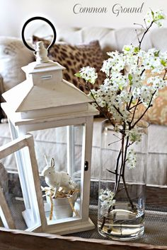 Create a lovely vignette by picking up a lantern from a home accessory store adding a favorite trinket and fresh flowers - FRENCH COUNTRY COTTAGE: Feathered Nest Friday #flowers #styling #vignette