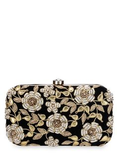 Black velvet clutch with gota, dabka and moti work in a floral vine motif on one side. The inside of the clutch is lined with satin and has a top clasp.Designer purses by Rusaru | Shop on www.jivaana.com for all your Indian weddings and festivals.  #jivaana  #indian #clutches