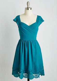 Thanks to this dress' nostalgic details, you've been caught up in daydreams since you slipped into its flowy A-line silhouette. This deep teal blue frock touts fluttery cap sleeves, a ruched sweetheart bodice, a lace-trimmed skirt, and an aura of whimsy.