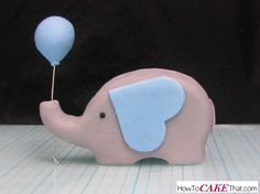 "Learn how to make this super cute ""elephant holding a balloon"" fondant baby shower topper! Easy tutorial with a free template :)"