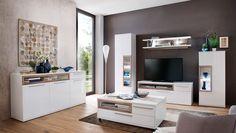 Wohnwand Pamplona Weiß HG mit Riviera Eiche 20752. Buy now at https://www.moebel-wohnbar.de/wohnwand-pamplona-weiss-hg-mit-riviera-eiche-20752.html