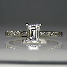 Trap cut diamond ring.