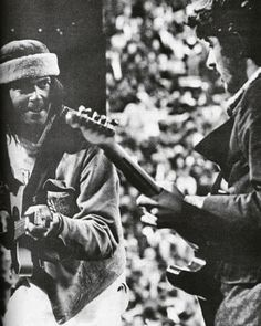Neil Young and Rick Danko play at Bill Graham's SNACK Benefit Concert in 1975.