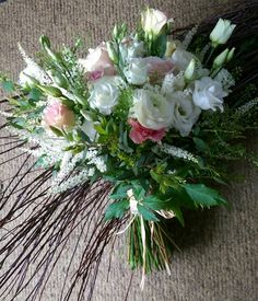 Soft pink and white country style hand tied bridal bouquet. designed by Enchanted Florals of glastonbury.