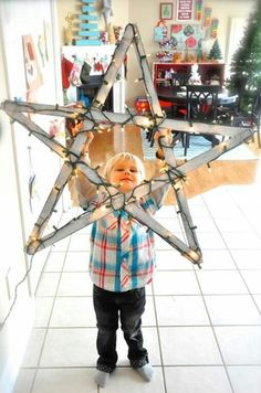 Christmas star made from 5 yard sticks & white lights from sugardoodle.net