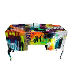 Give your ho-hum decor a modern updateSide of Graffiti  Dramatic strokes of color and graffiti-inspired lettering give an antique Louis XIV sideboard some street-wise urban hipness. Known for their revamped conversation pieces, the UK-based Jimmie Martin protects each original signed art piece with a high gloss varnish.  SHOP NOW: Jimmy Martin In Your Face, $5,775