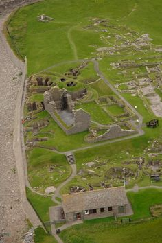 Jarlshof - near Sumburgh, Shetland Islands, Great Britain;  the Viking settlement of the Jarlshof site was hidden until a storm in the late 1800s exposed some of the remains from late Iron Age buildings (before 800 AD);  built in a circular fashion around a central hub with small rooms and storage areas leading off of it.