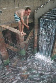 3D  sidewalk chalk illusion! If viewed from a different angle, you would see that it's totally flat! This is by Julian Beever, famous for his art.
