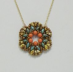 I designed this pendant for Summer. I have a friend who says it reminds her of the Southwest, it reminds me of the Caribbean....either way its a beauty! I started with 4mm Genuine Swarovski Coral pearls - added Turquoise Picasso SuperDuos - added Chalk Travertine SuperDuos, sprinkled it with Galvanized Bronze seed beads & added the 14K/20 Gold Filled cable chain. Its about equal to a 19 chain - the medallion itself is about 1 1/2 inches wide. MAKE IT A SET! Buy this pendant and the…