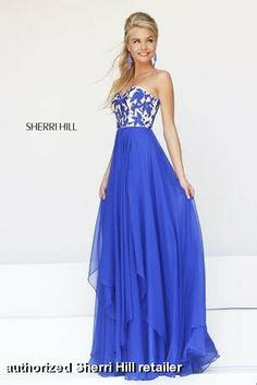 Stand out of the crowd in this Royal Blue/Nude Sherri Hill dress with a gorgeous strapless sweetheart bodice with an embroidered leaf motif and attached silk chiffon layered skirt!