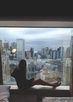 My office in NYC was like this... I looked right at the twin towers.. overlooking all the buildings inbetween. I would close the door and sit on climate unit just like this...
