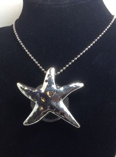 A personal favorite from my Etsy shop https://www.etsy.com/listing/267585813/starfish-magnifying-glass-necklace-on-30