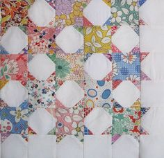 two blocks, one plain, one with triangle corners. quilt