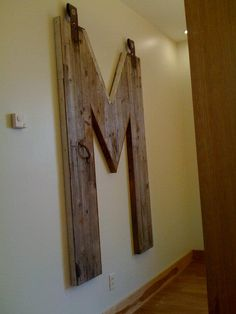 "ReHouse customer made a giant ""M"" using barn wood from our store- architectural salvage and repurpose."