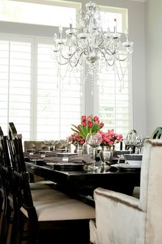 Elegant dining room. romantic chandelier. i like comfy chairs