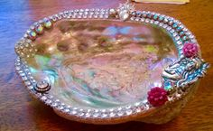 Abalone shell bejeweled with vintage and new adornments.